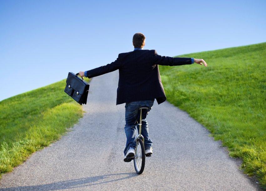 man balancing on bike